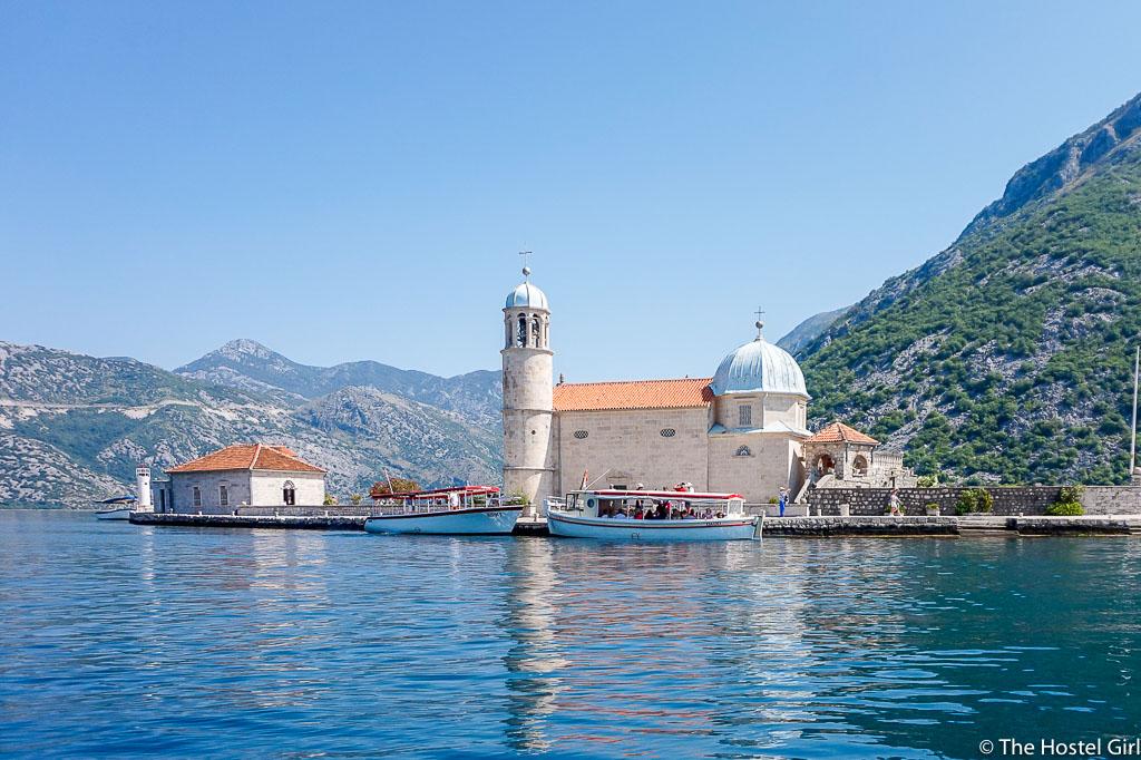 https://thehostelgirl.com/wp-content/uploads/2016/07/Bay-of-Kotor-The-Legend-of-Our-Lady-of-The-Rocks-Gospa-od-Skrpjela-Montenegro-1.jpg